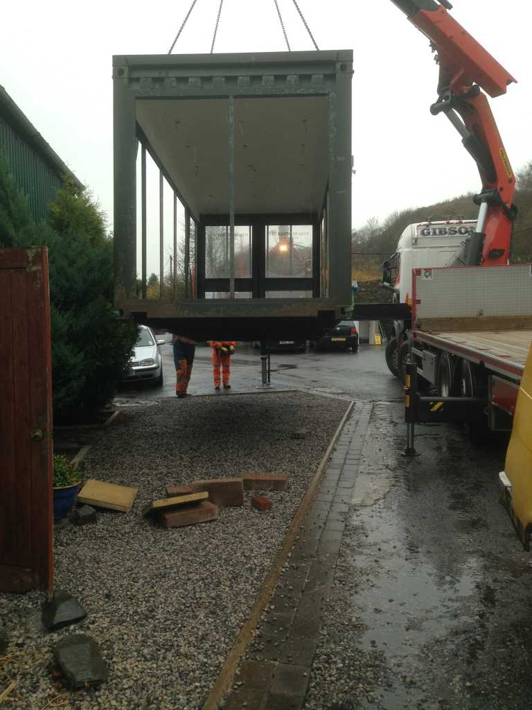 Our Shop being lowered to the ground